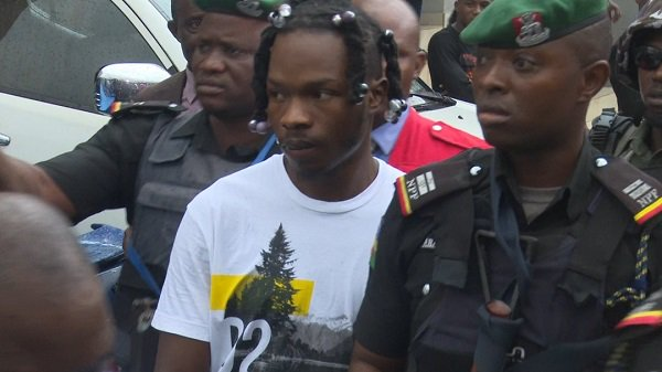 Image result for Fans gather as Naira Marley appears in court for bail hearing (Video)