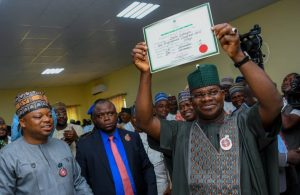Image result for INEC presents Certificate of Return to Gov Yahaya Bello""
