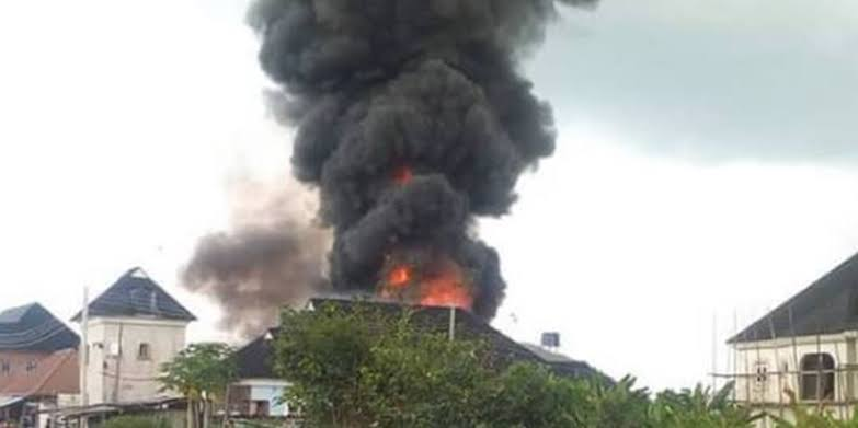 Image result for Fire reportedly guts cornerstone road opposite AIT Port Harcourt""